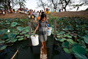 Dala township, Burma: people line up to collect water
